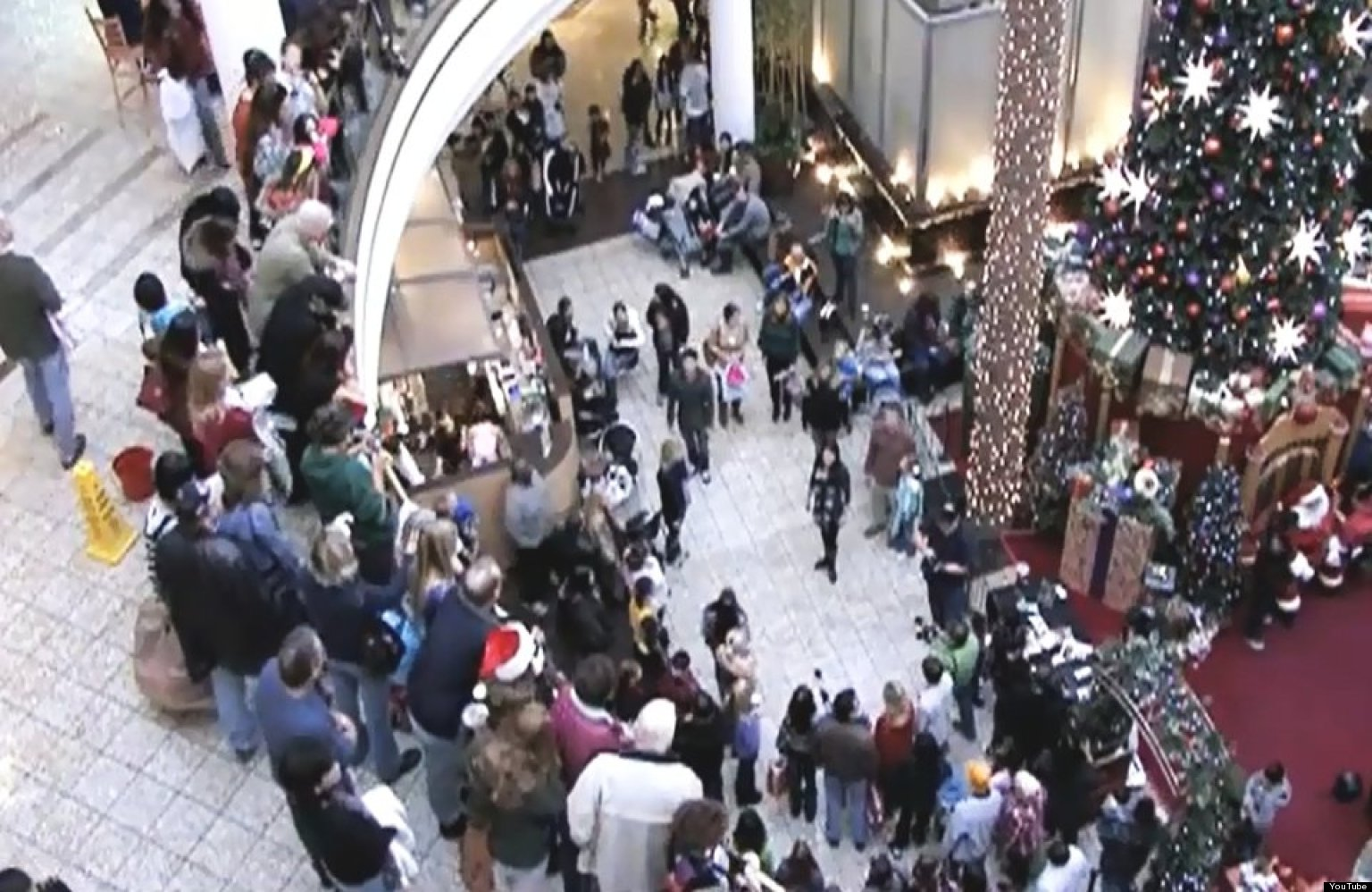 christmas carol flash mob takes over shopping mall  video
