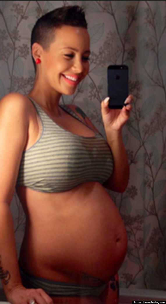 Amber Rose's Nude Baby Bump: Pregnant Model Posts Picture Of Her Bare ...