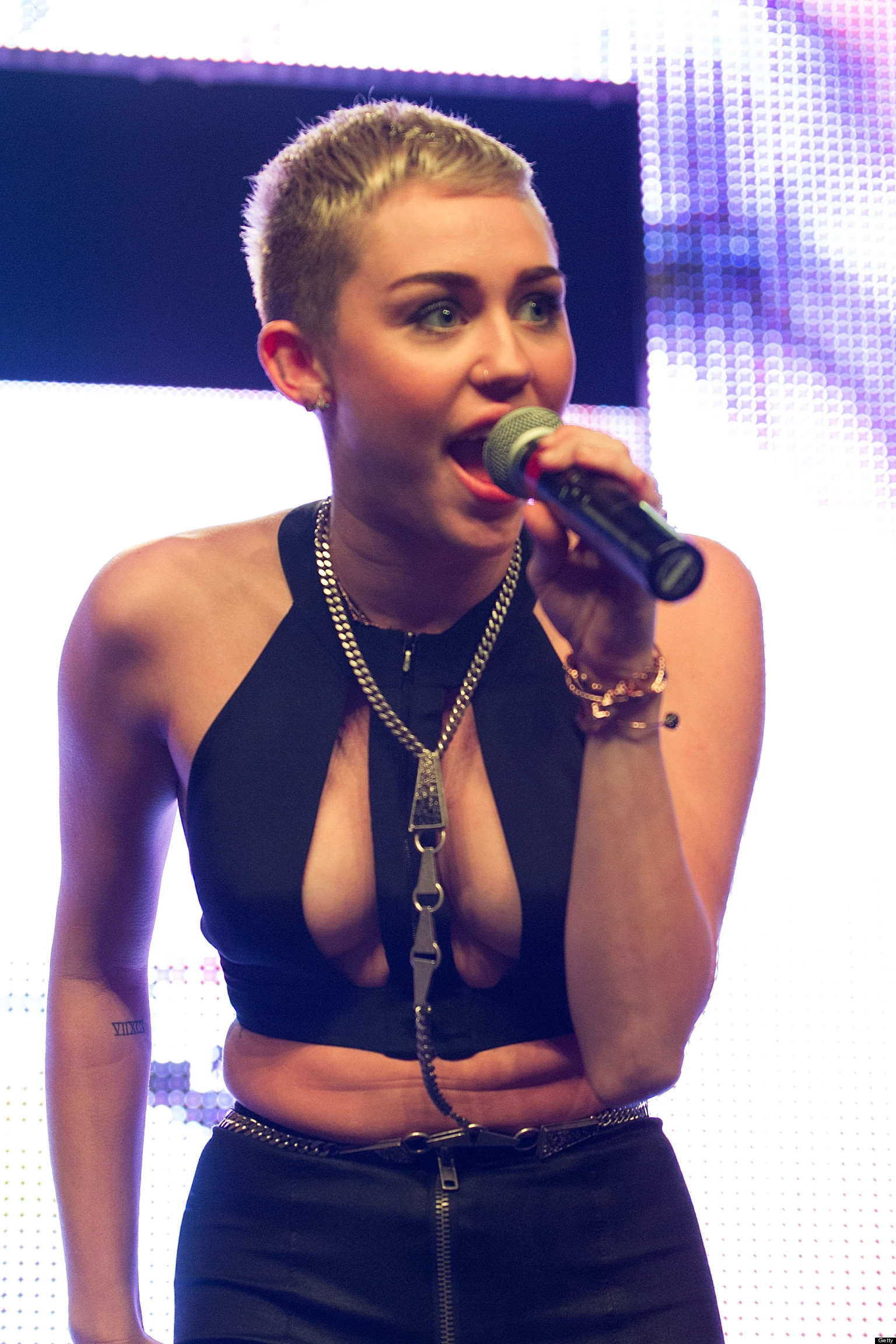 Miley Cyrus Dances With Stripper In Wild Christmas