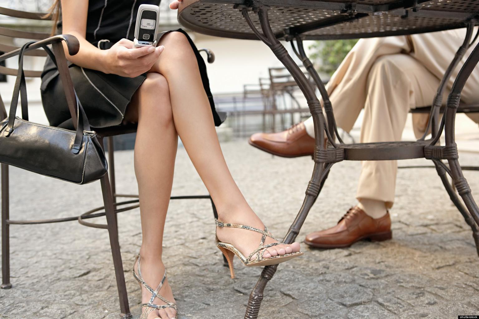 Под столом ногой в трусы к женщине