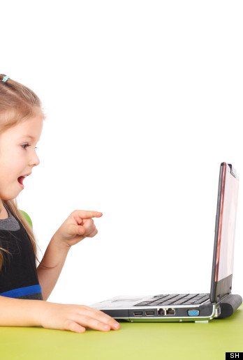 A Young girl learning from a computer
