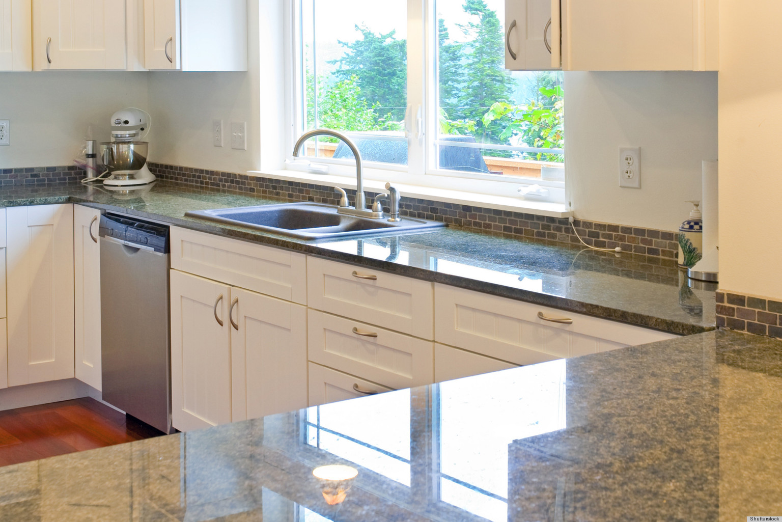 Unclutter your life clearing the kitchen counter of for Kitchen countertops