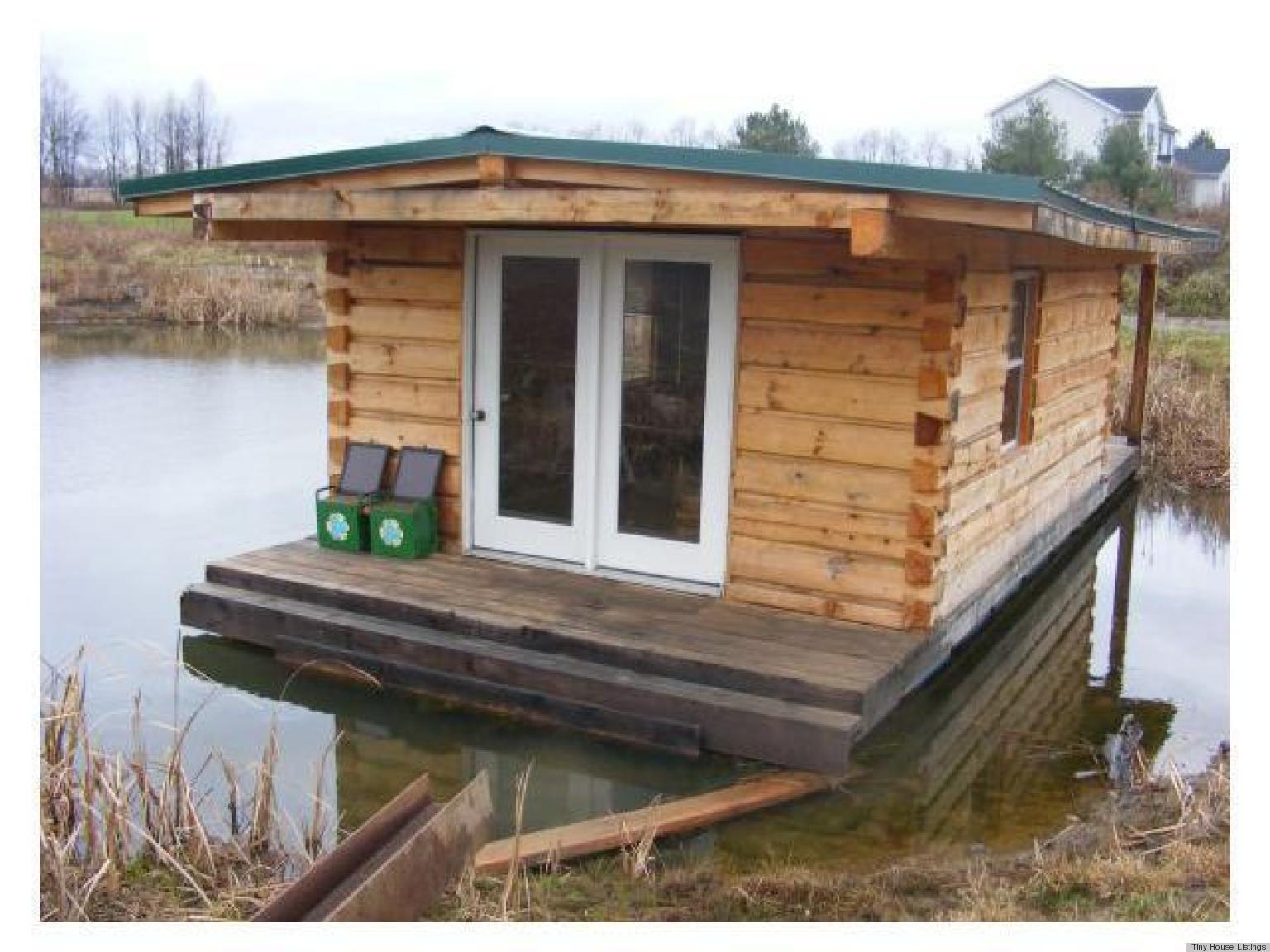 A floating log cabin that combines tiny home living and for Small luxury cabin