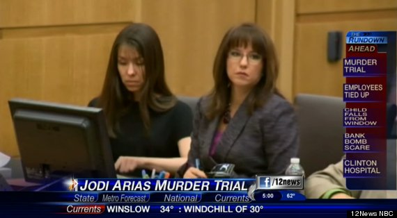 Jodi Arias (left) looks down as her lawyer, Jennifer Willmott, looks ...