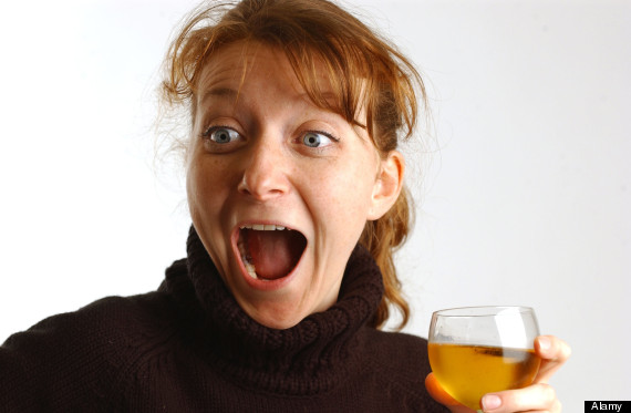 ginger woman drinking wine