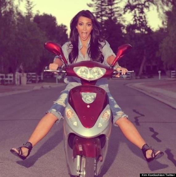 pregnant kim kardashian rides bike