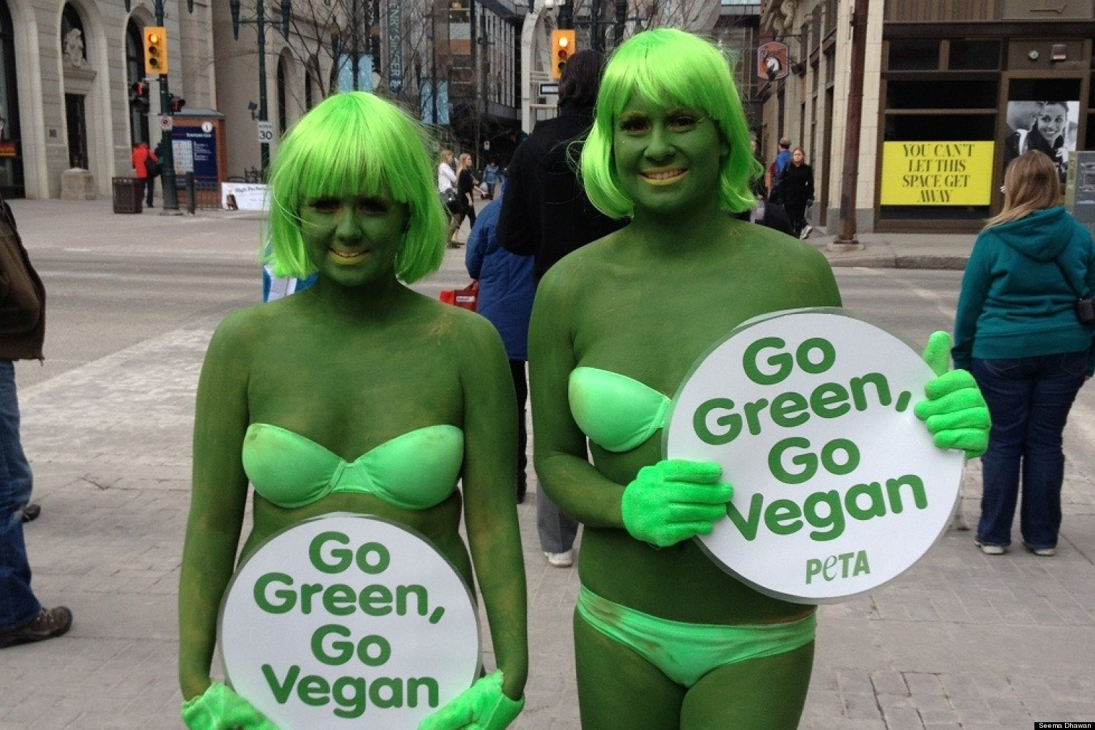 PETA Protest Calgary: Activists In Green Bikinis, Bodypaint On Stephen Avenue Ask Calgarians To ...