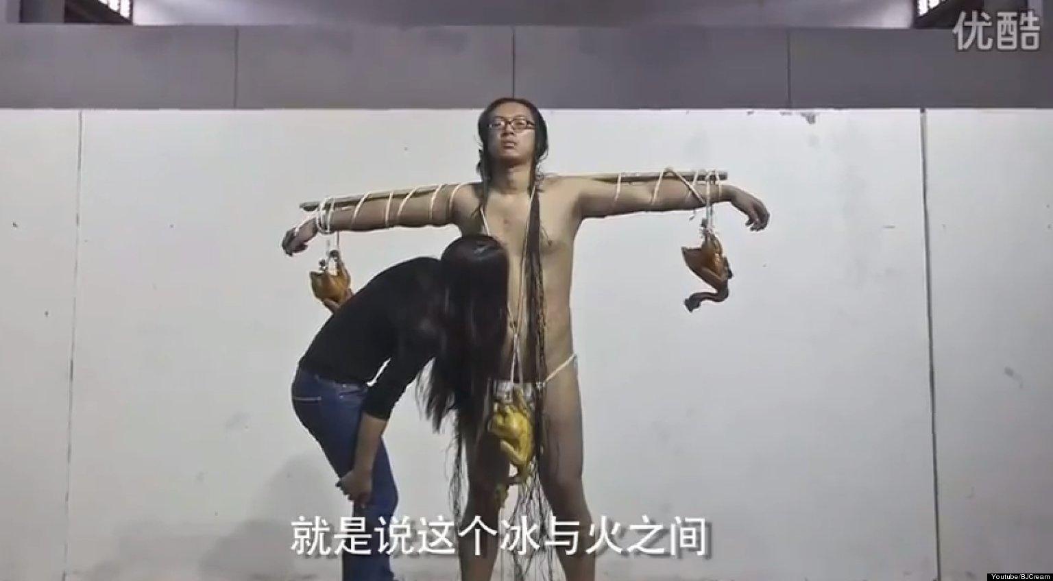 Chinese Artist Kang Yi Receives Hickeys As Performance Art