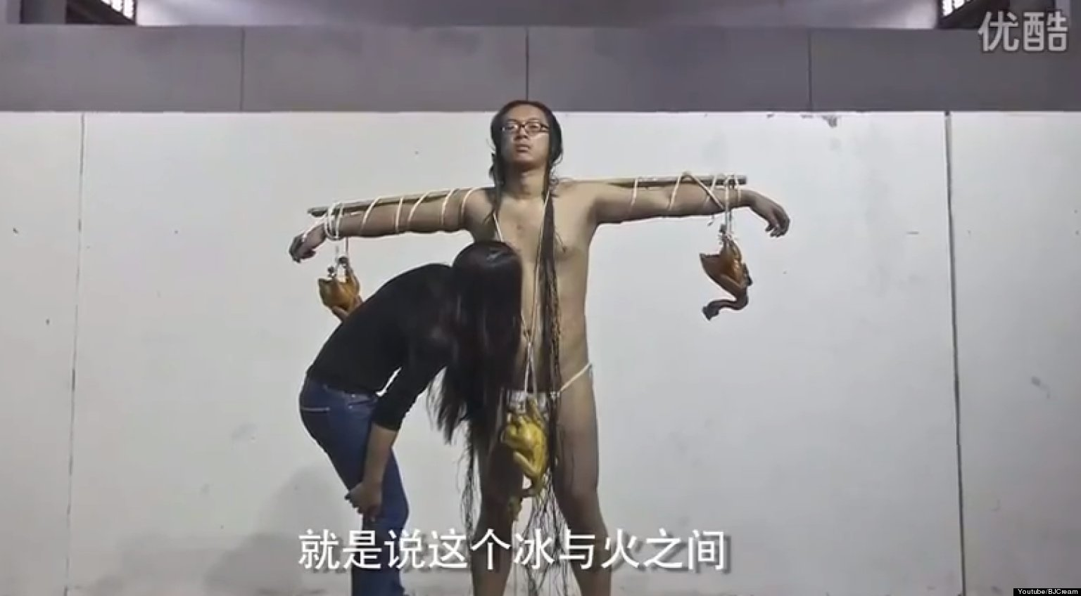 chinese artist kang yi receives hickeys as performance art nsfw video. Black Bedroom Furniture Sets. Home Design Ideas