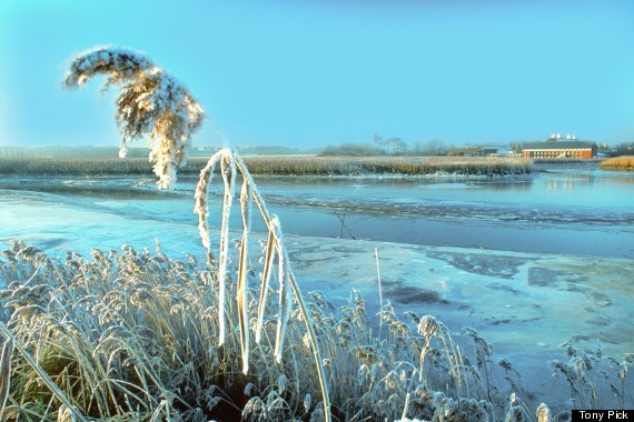 snape maltings in winter across river alde on the
