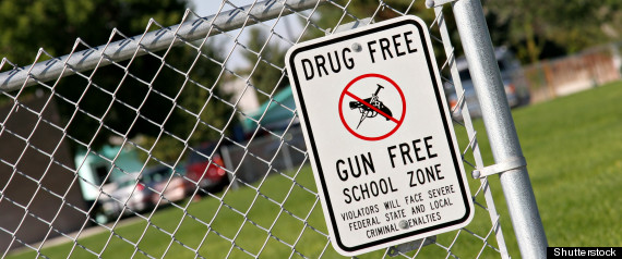 School fence with Drug Free Gun Free sign
