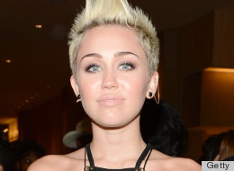 PHOTOS: Miley Cyrus Spills Out Of Her Dress