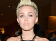 Miley Cyrus Flashes Sideboob, Almost Pops Out Of Dress At Pre-Grammy Party (PHOTOS)
