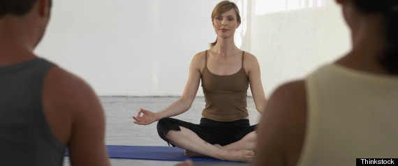 YOGA TEACHER SITTING CROSSLEGGED
