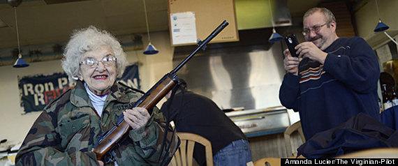 GRANDMA POSES WITH GUN